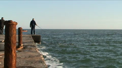 A man fishes - stock footage