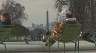 Autumn in Paris -  relaxing with newspaper in public Stock Footage