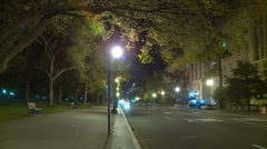 Wash DC, E Ave traffic at night adjacent to the White House Stock Footage