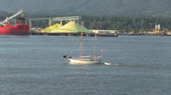 Sailboat Sails by Port with Sulfur in Vancouver Stock Footage