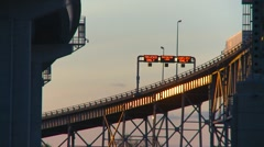 Trucking, transport trucks on Blue Water Bridge, sun glint on trailers Stock Footage