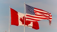 Flag, huge US and Canada flags, neighbors together Stock Footage