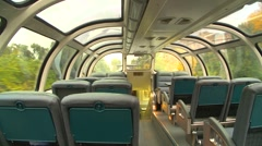 Railroad, on board empty dome car going through city Stock Footage
