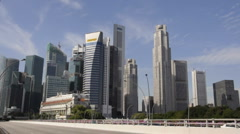 Time-lapse of vehicles moving in Singapore Central Business District Stock Footage