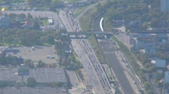 aerial time-lapse, afternoon rush hour freeway and trains - stock footage
