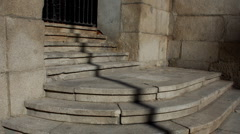 Stairs and church door covered by shadows Stock Footage