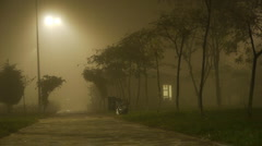 foggy-whether-at-night-small-house - stock footage