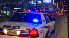 Crime and justice, police, Toronto police car, Yonge street night Stock Footage