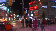 Yonge Dundas square night pan east Stock Footage
