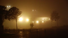 Stock Video Footage of romantic-couple-walking-on-a-foggy-night HD