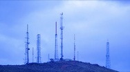 Stock Video Footage of Timelapse Telecommunications Towers at Sunset