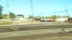Rail travel - entering rail yards, pass very close to box cars in siding Stock Footage