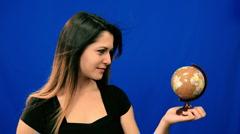Blue screen beautiful girl hold globe windy hair - stock footage