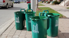 Toronto recycles. Empty green organic waste bins on the curb after pickup. Stock Footage