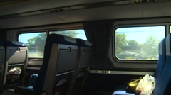 Railroad, riding coach class on a passenger train, the view across the aisle Stock Footage