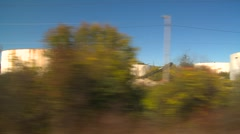 Rail travel, passing fuel tanks and industry Stock Footage