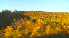 view passing hilly upstate NY autumn colours - stock footage