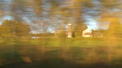 Stock Video Footage of Upstate New York, passing countryside autumn colours trees farms & homes