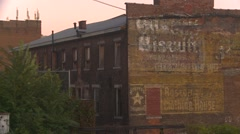 Railroad, passing old warehouses, weathered signage and downtown Stock Footage