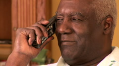 Portrait of senior man indoors talking on cell phone Stock Footage