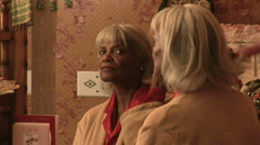 Senior woman combing grey hair by mirror in bedroom Stock Footage