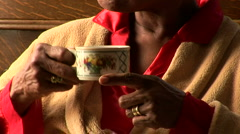 Close up of senior woman drinking tea by bedroom window Stock Footage