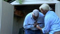 Senior couple frantic with husband having a heart attack Stock Footage