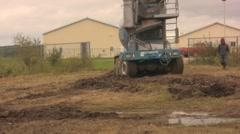 Redimix truck driving through mud Stock Footage