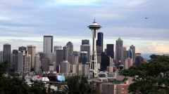 Stock Video Footage of Downtown Seattle Skyline with Plane Flying