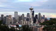 Downtown Seattle Skyline with Plane Flying Stock Footage