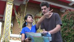 Asian Girl Helping Lost Foreigner Stock Footage