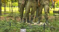 Wash DC, Vietnam vet Monument 3 troops tilt shot - stock footage