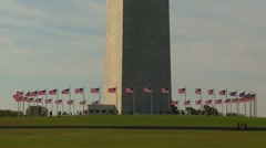 American Icons #38 Wash DC, Wash Monument base tight shot flags Stock Footage