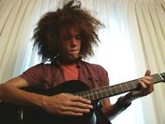 Stock Video Footage of African American man play guitar with afro - slow motion