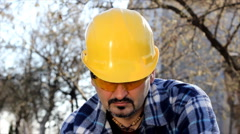Man cutting wood with electric saw Stock Footage