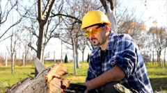 Man cutting wood with electric saw - stock footage
