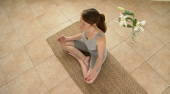 Young woman meditating - stock footage
