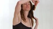 Stock Video Footage of Woman brushing hair
