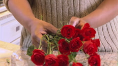 Woman smelling red roses indoors Stock Footage