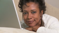 Portrait of relaxed woman with laptop - stock footage