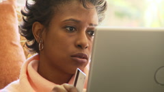 Woman purchasing with credit card over the internet Stock Footage