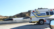 Stock Video Footage of Freeway Accident - EMT at the Scene