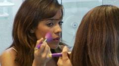 Young Woman Applying Makeup Stock Footage