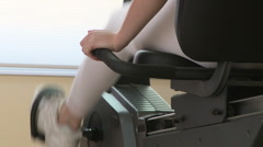 Woman exercising on stationary bike Stock Footage