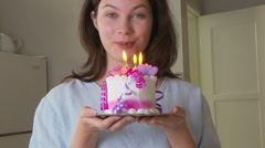 Young woman in kitchen with birthday cake Stock Footage