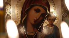 Stock Video Footage of Icon Icon of the Virgin Mary with baby Jesus.Candles .1a