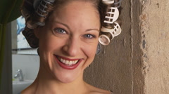 Woman with curlers in hair Stock Footage