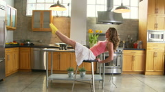 Woman being goofy kitchen - stock footage