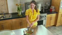 Woman being goofy in kitchen - stock footage
