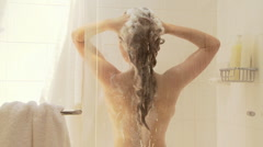 Woman washing hair in shower Stock Footage